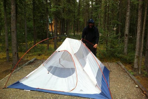 Gregg Wearing a Mosquito Net Setting Up The Tent